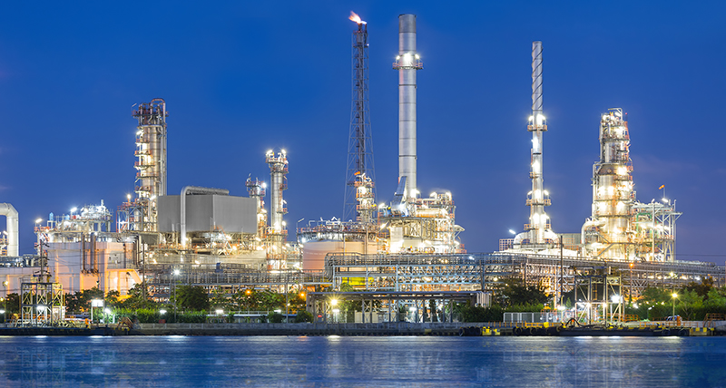 case study, Litwin, refinery near water, evening